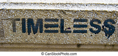 graffiti of the word timeless on a brown wall
