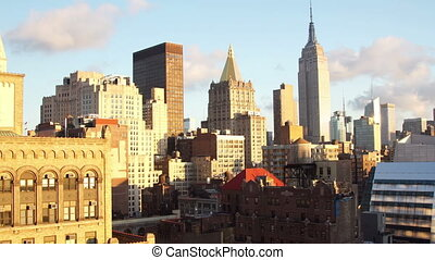 timelpase of midtown manhattan skyline with empire state from a high vantage point in the morning