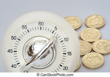 Timer in close up with group of coins