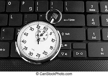 Timer on Black - Silver stopwatch on black laptop keyboard...