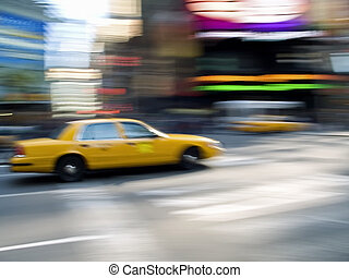 Times Square Taxi - A panned abstract of a taxi cab speeding...