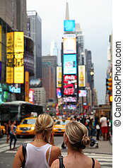 Times Square - Two girls on the blured Times Square...