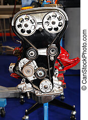 Open cover of timing belt drive in automobile engine