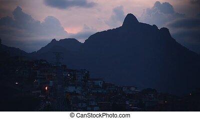 Timlaps shooting of the nightfall in the favelas of Rio da...