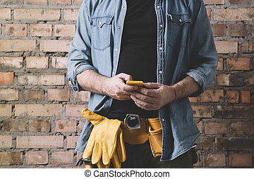 timmerman, op de telefoon
