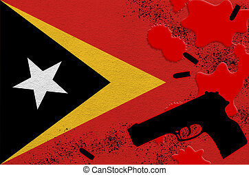 Timor Leste flag and black firearm in red blood. Concept for terror attack or military operations with lethal outcome. Dangerous handgun usage