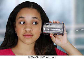 Tin Can Phone - Teen girl listening to a tin can phone