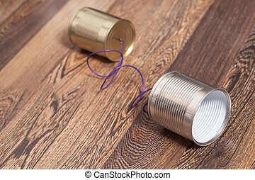 Tin Can Phone Wooden Background.Communication concept