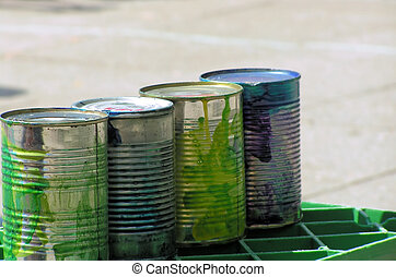 Tin cans on crate