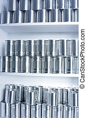 Tin cans stacked on shelves