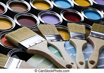 Tin cans with paint and brushes