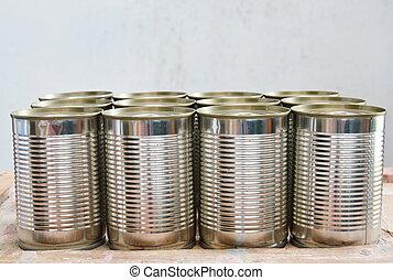 tin food can on wood board