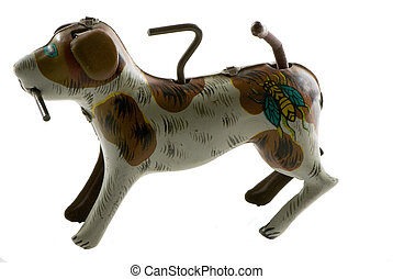 antique tin win-up dog with stick in his mouth, isolated