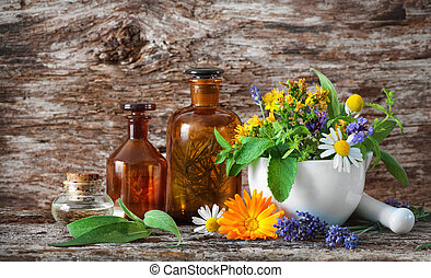 Herbal medicine. Medicinal plants - Tincture bottles and...