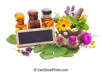 Tincture bottles and healing herbs in mortar isolated on...