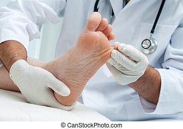 Tinia pedis or Athletes foot - Doctor dermatologist examines...