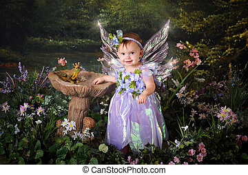Tinkerbell - A beautiful baby girl with sparkly wings in...