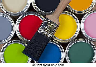 Tins of colorful paint