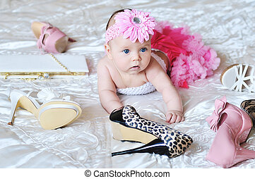 tiny and fashion - baby girl wearing tutu laying on the bed...