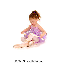 Tiny Ballet Dancer playing dressup in Pointe Shoes