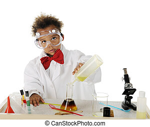 Tiny Chemist - An adorable tot mixing chemicals on his...