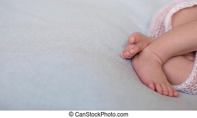 tiny cute legs sleeping newborn baby