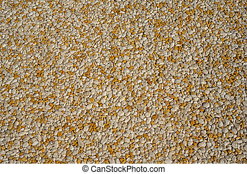Tiny gravel texture on brown concrete wall. Texture background seamless gravel floor.