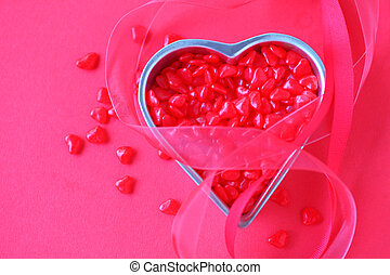 Tiny heart candies with ribbons