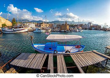 Tiny old boat moored in Kyrenia harbor. Cyprus