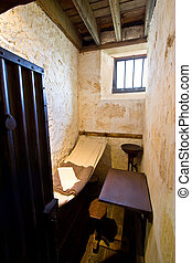 Tiny old prison cell
