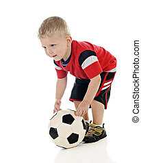 Tiny Soccer Player - An adorable 2-year-old positioning his...
