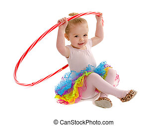 A Tiny Dancer in preschool having fun with hula hoop and colorful tutu