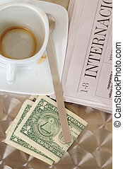 Currencies and cup of coffee