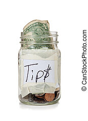 Tip jar with money  - a tip jar with coins and bills
