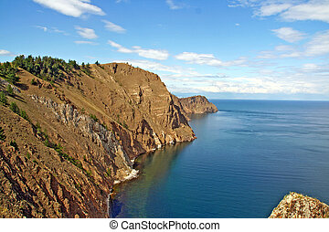 Tip of Olkhon island surrounded by Lake Baikal, Russian...