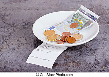 Tip on a restaurant table - Tip and bill on a gray ...