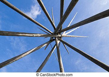 Tipi poles - Teepee poles under blue sky
