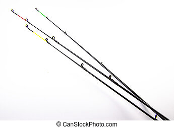 Tips of fishing rods on a white background