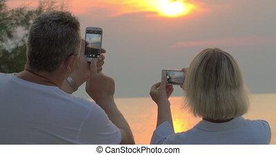 tir, smartphones, coucher soleil, mer, gens