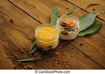 tiramisu and lemon custard desserts on wooden background...