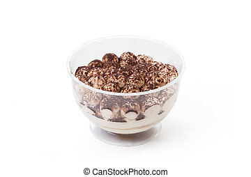 Tiramisu cake in glass cup isolated on white