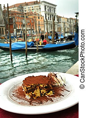 Tiramisu cake on Venice canal background