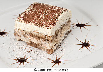 Tiramisu cake - Plate of tiramisu cake decorated in a ...