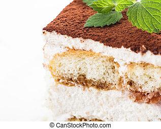 Tiramisu cake slice, close up view on the plate