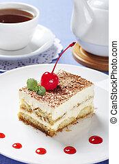 Tiramisu - Classical Dessert with Coffee on white plate. ...