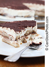 Tiramisu - Close-up of delicious tiramisu cake on a plate. ...