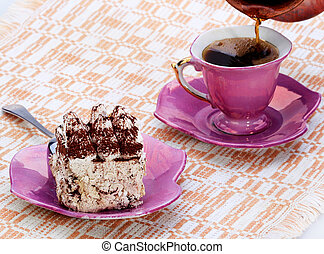Tiramisu dessert on a plate, pour a cup of coffee in the coffee