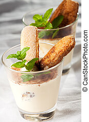 tiramisu in a glass with peppermint leaf