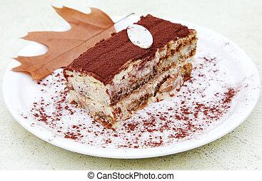 tiramisu slice - piece of tiramisu cake on a plate with ...