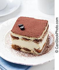 Tiramisu, traditional Italian dessert on a plate